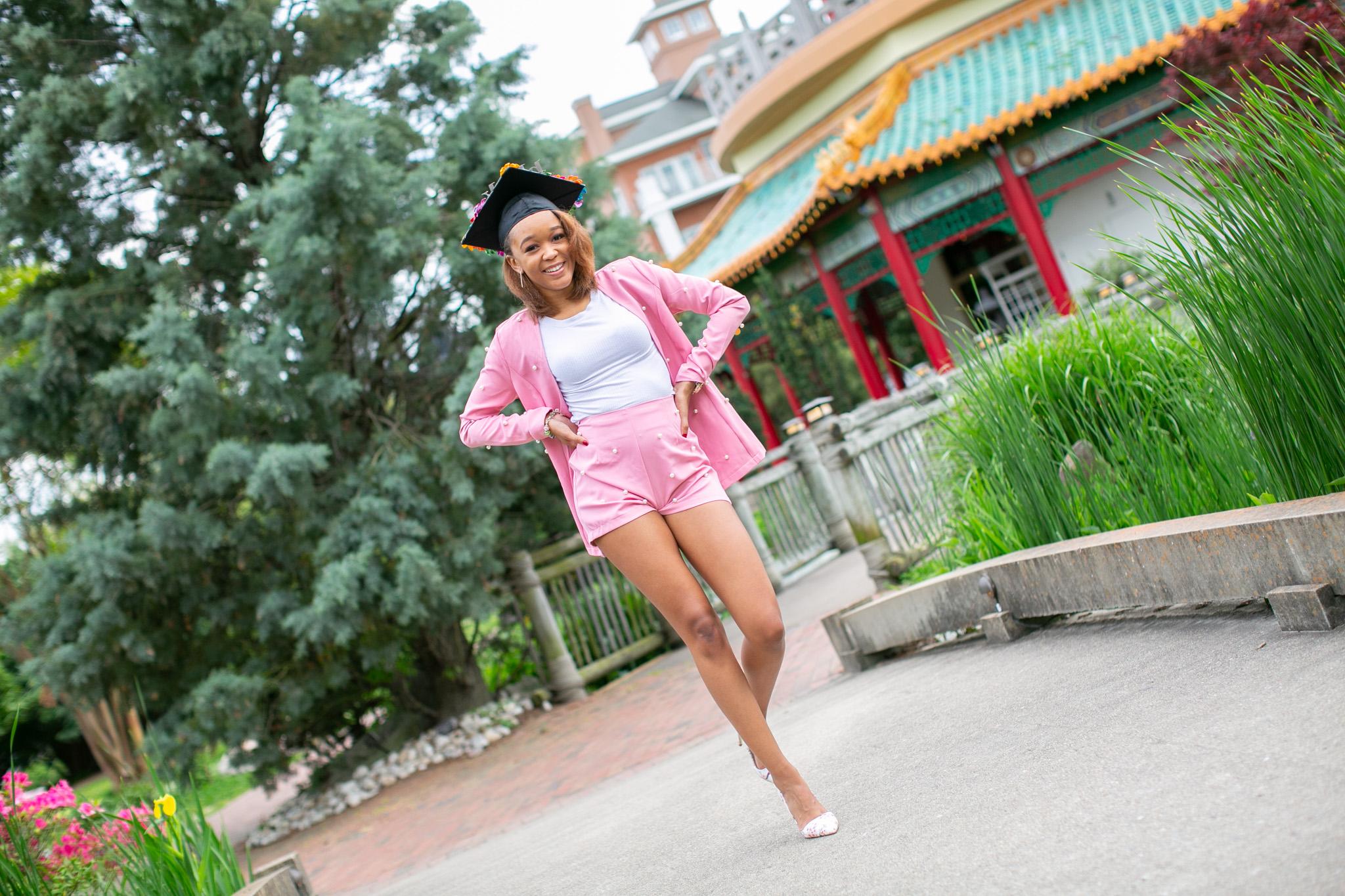 graduate walking in garden