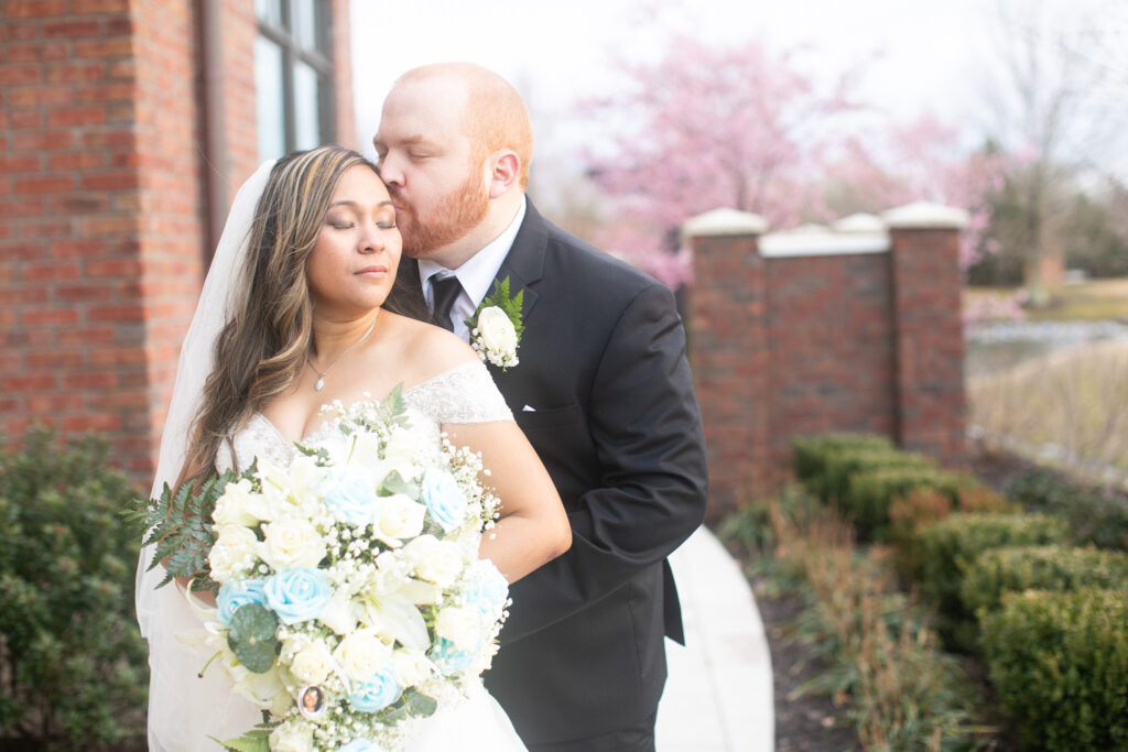 Bride and groom kissing at Noah's event venue