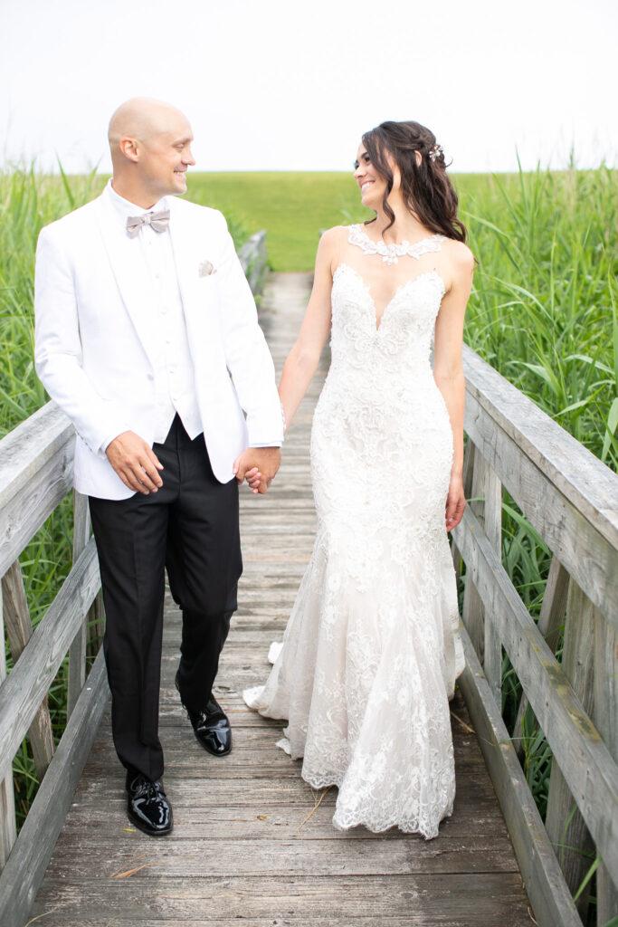 bride and groom at golf club walking