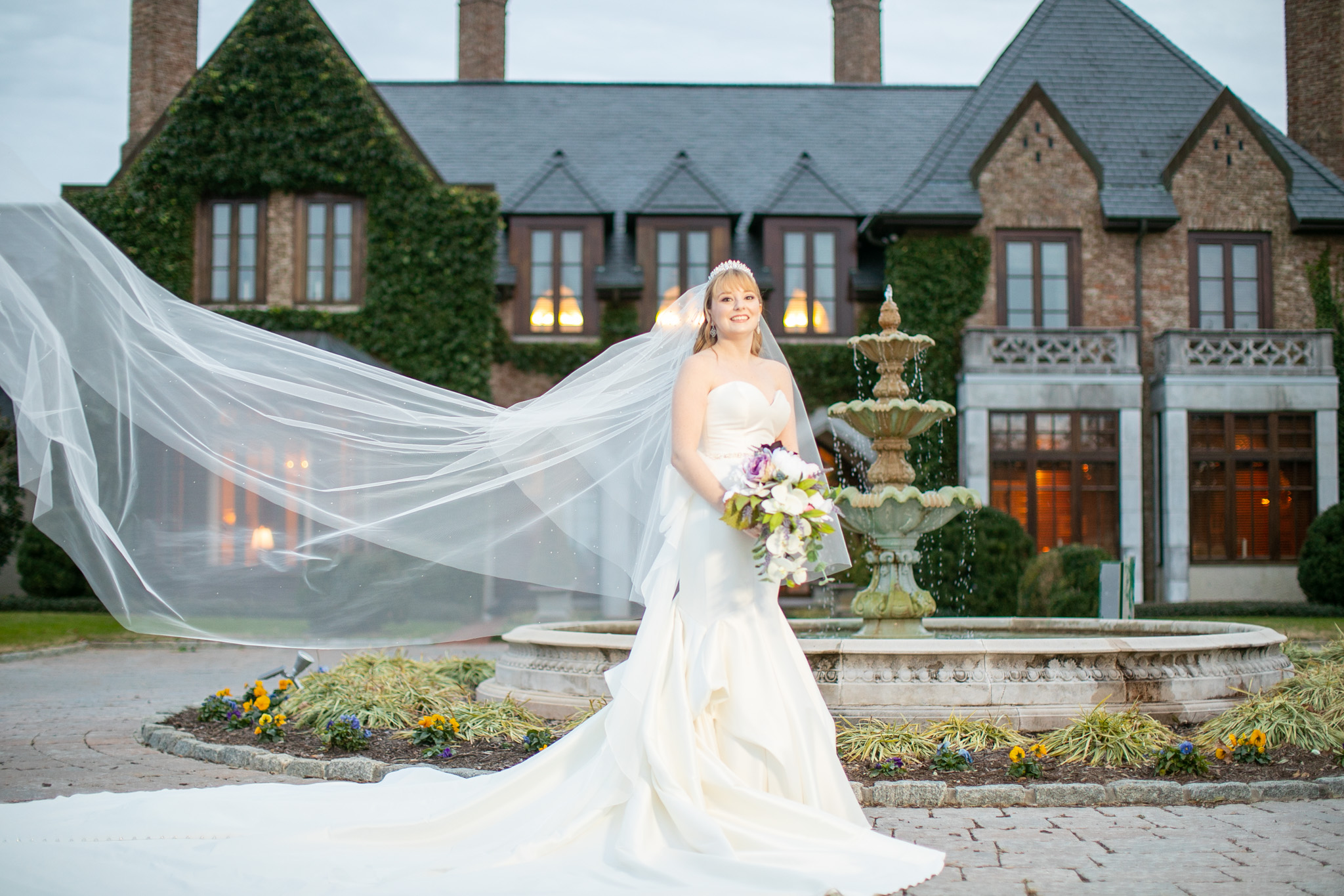 bride in front of mansion